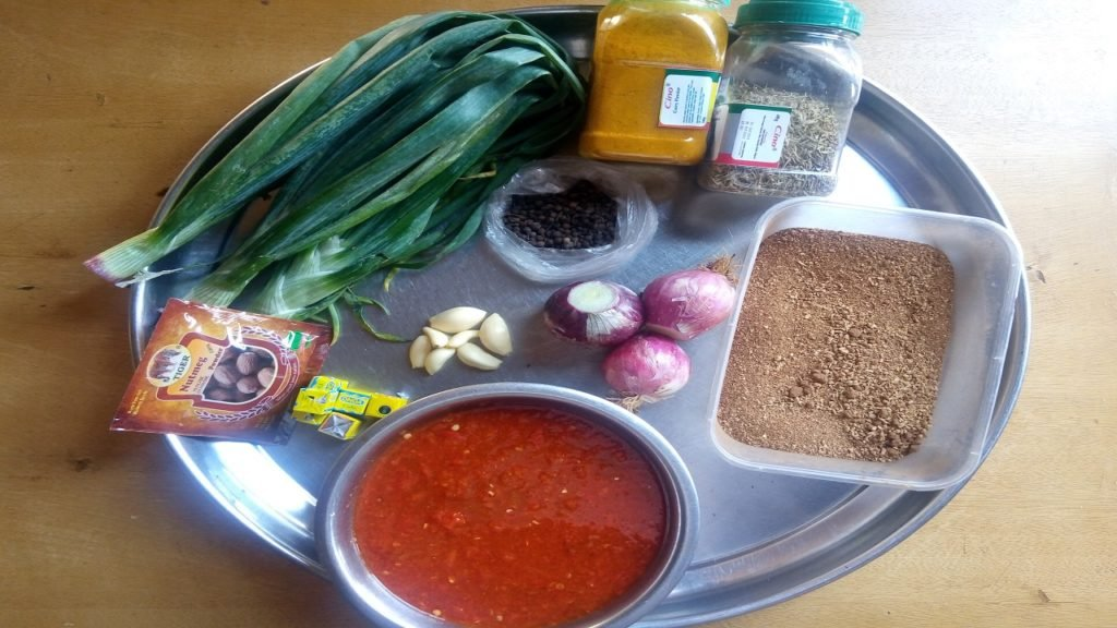 Spring onions, Curry, Thyme, Spices, Oziza seeds, Garlic, Powdered nutmeg, Seasoning cubes, onions and Blended pepper